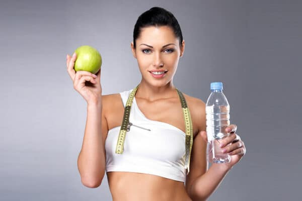 woman with apple and water