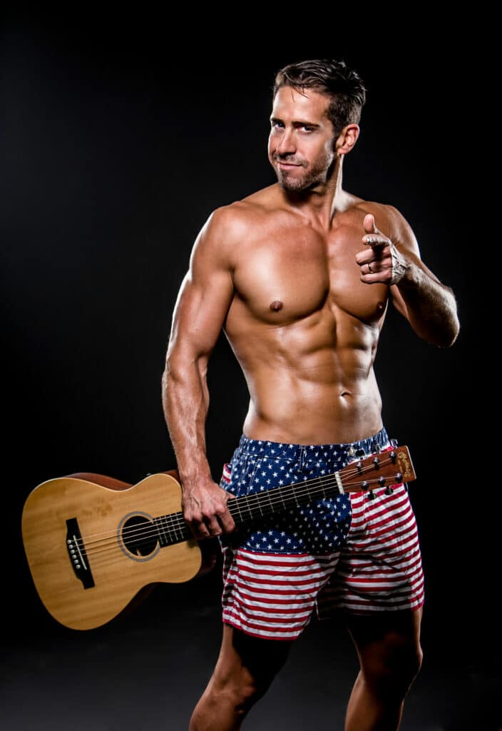 Stark Naked Competition man holding guitar